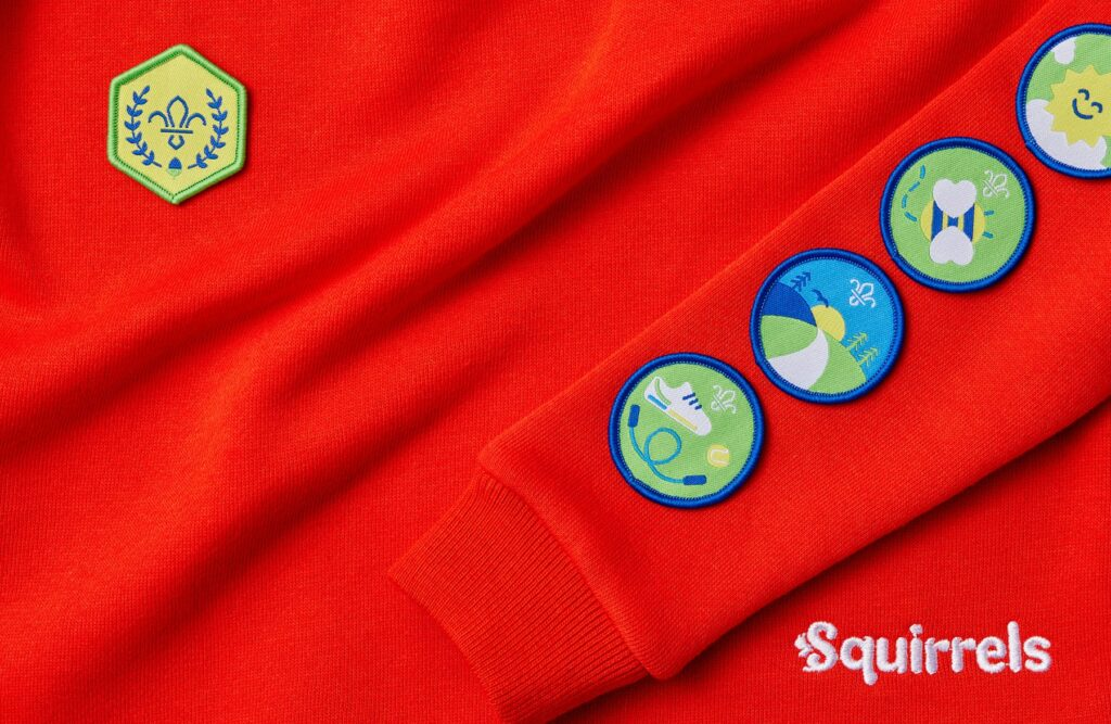 Squirrels jumper and some of the badges and awards they can achieve